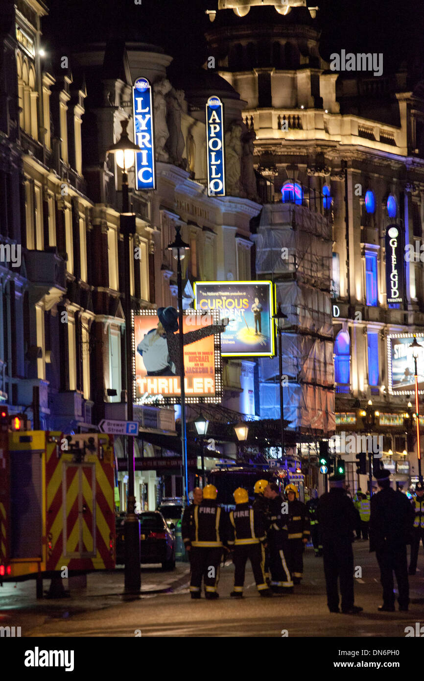London, UK. 19th Dec, 2013. Emergency services work outside the Apollo Theatre where part of the ceiling had collapsed and injured a large number of people. Credit:  nelson pereira/Alamy Live News - Stock Image