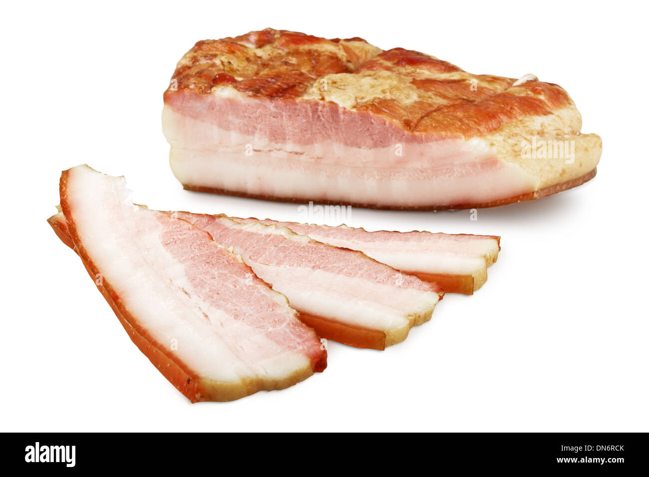 bacon section isolated. Focus on the slices - Stock Image