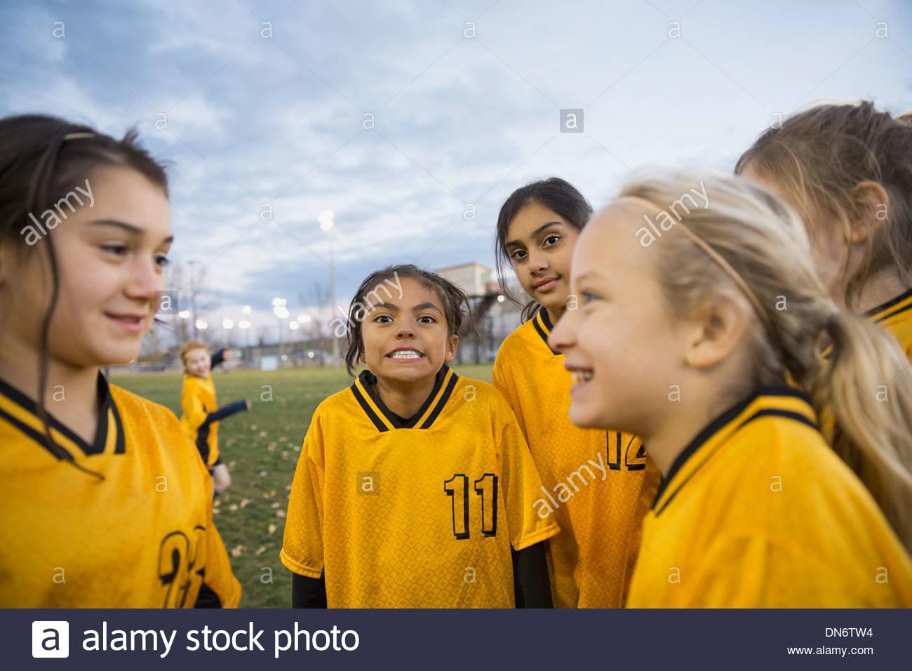Soccer team on field at dusk - Stock Image