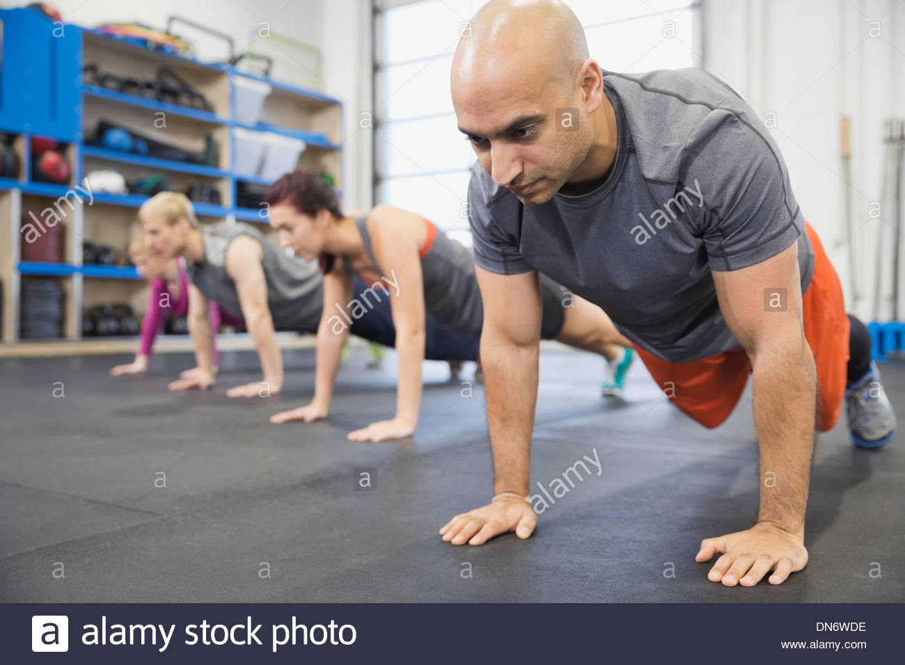 Man practicing plank hold - Stock Image