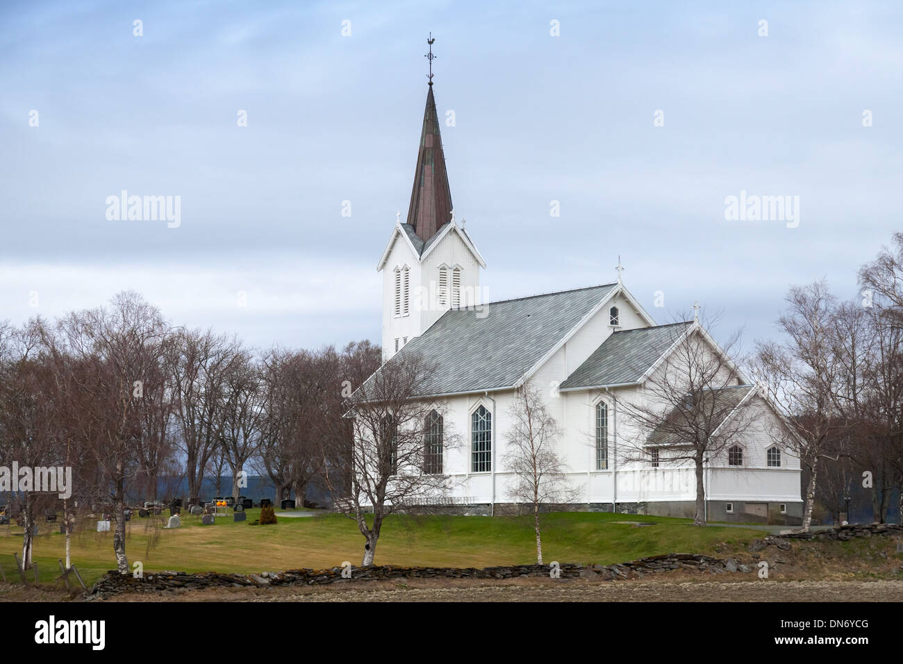 Traditional white wooden Norwegian Lutheran Church in small village Stock Photo