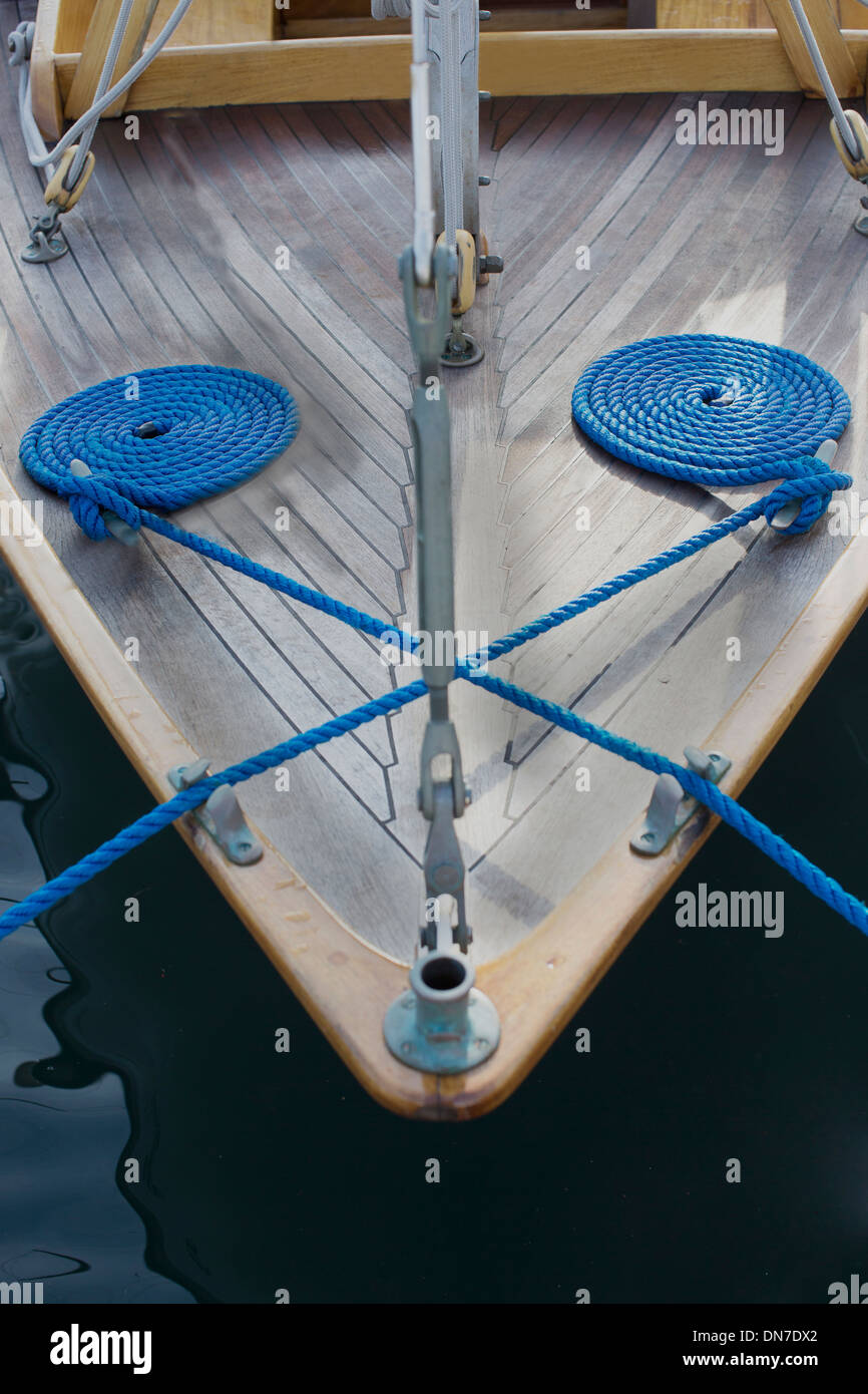 coiled ropes on boat - Stock Image