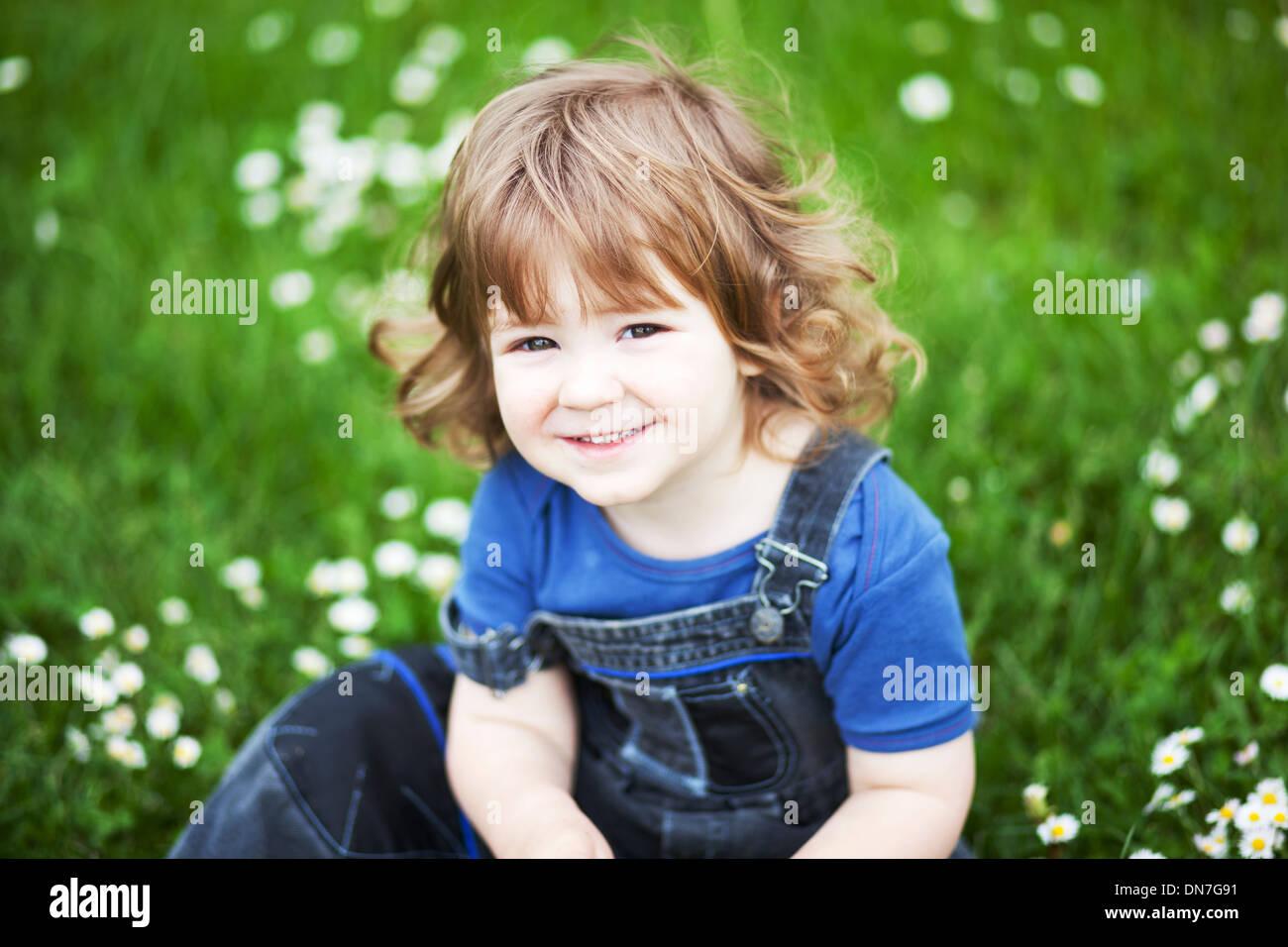 Portrait of a little smiling boy - Stock Image