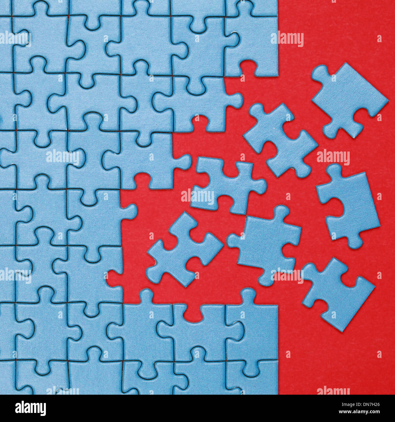 Pieces of a jigsaw puzzle have to be put in the right place - Stock Image
