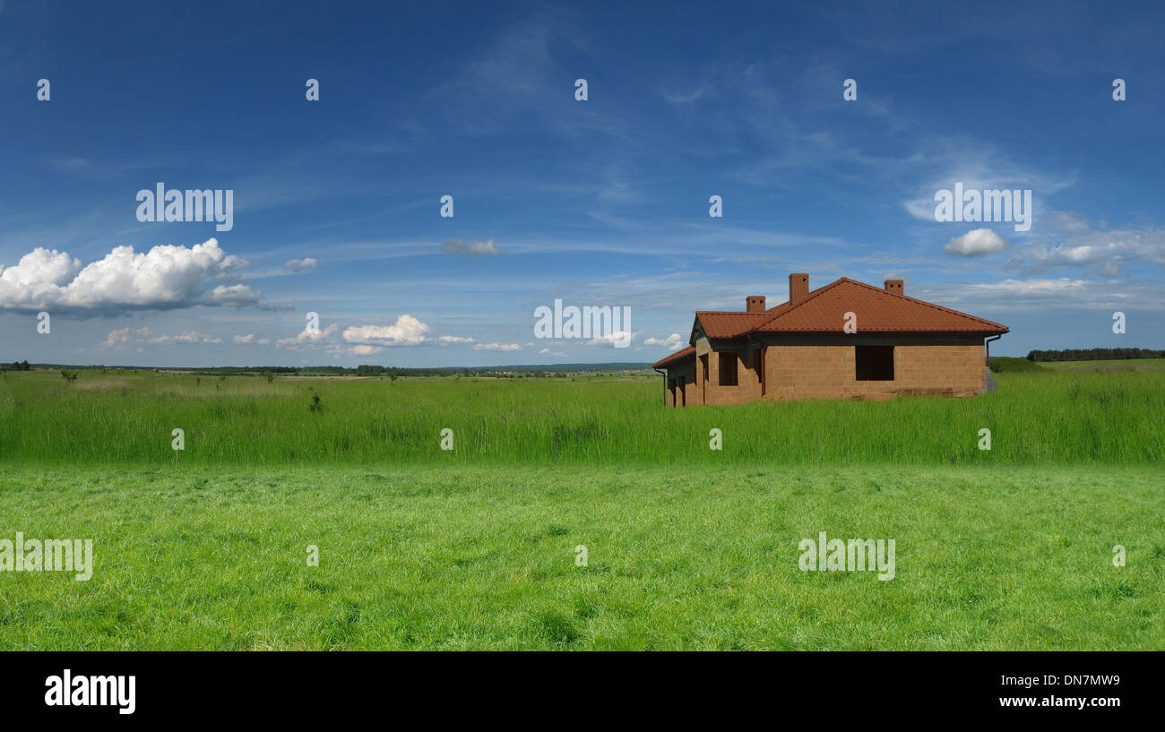 building of little house on sky background - Stock Image
