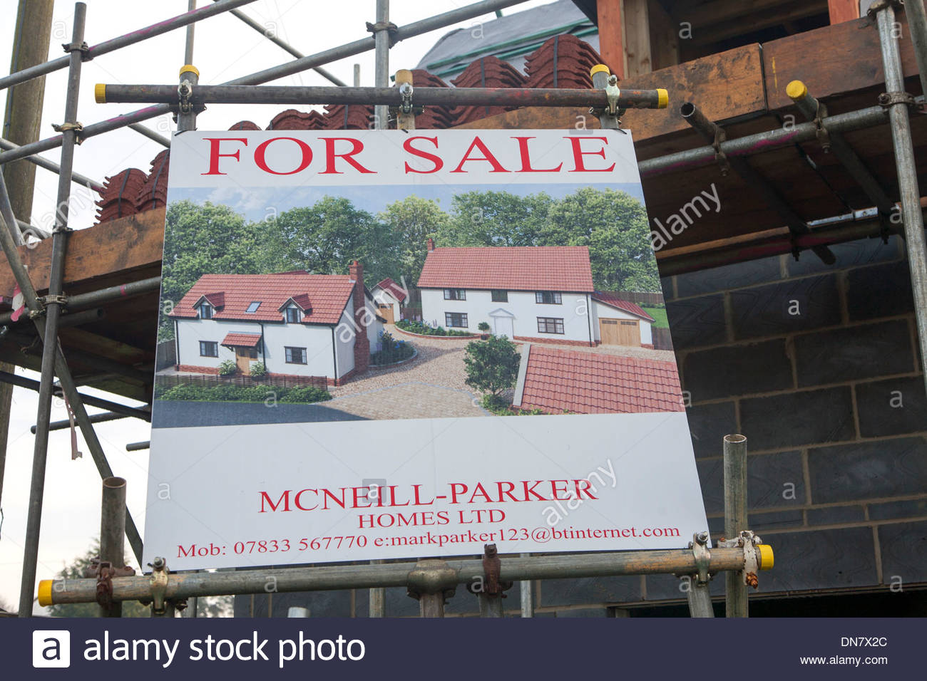 New house for sale advert at building construction site UK - Stock Image