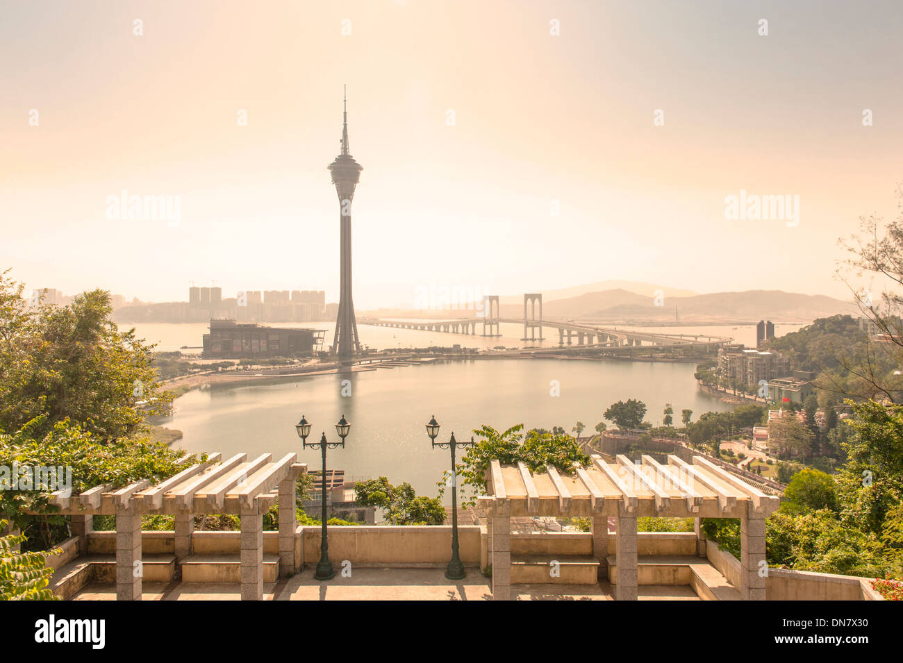 Macau tower seen from Penha hill, a landmark building, dining venue and viewing tower at Macao, SAR of China - Stock Image