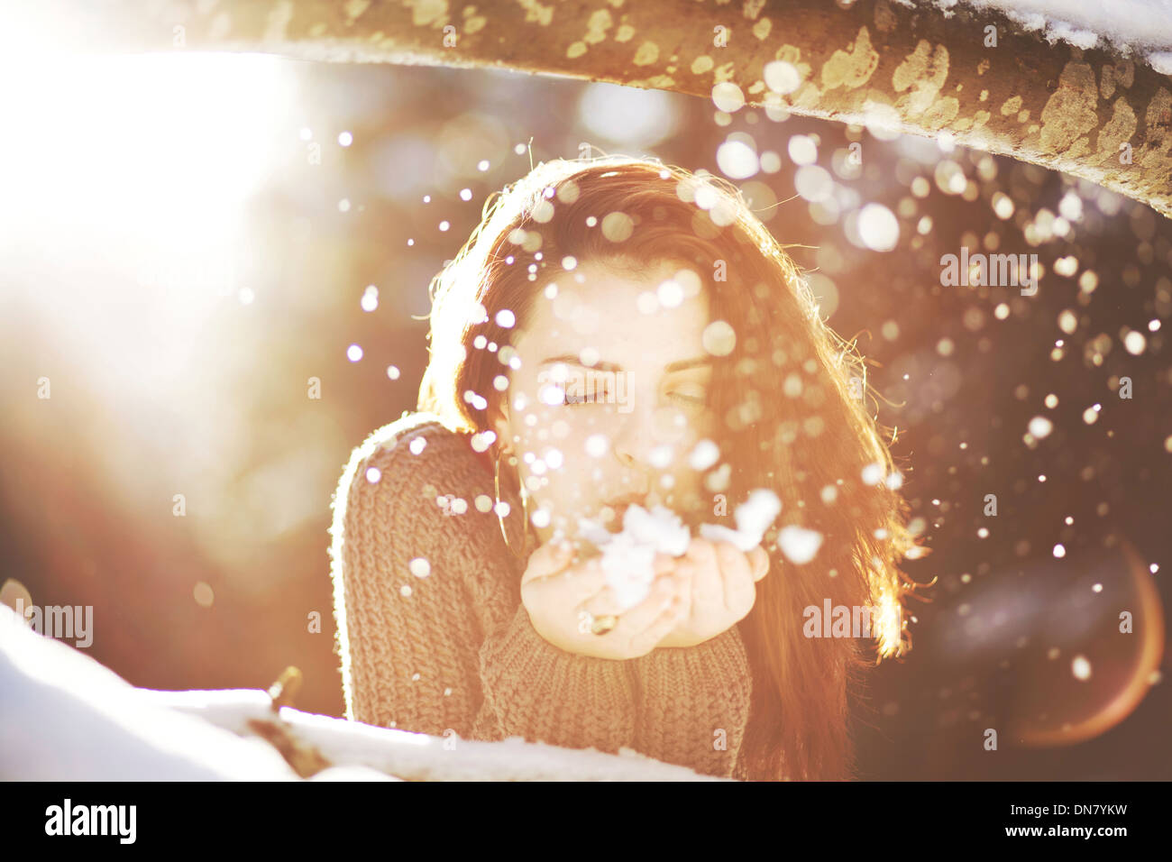 Portrait a young woman in snow in backlight Restrictions:This image has additional restrictions.Please contact us. - Stock Image