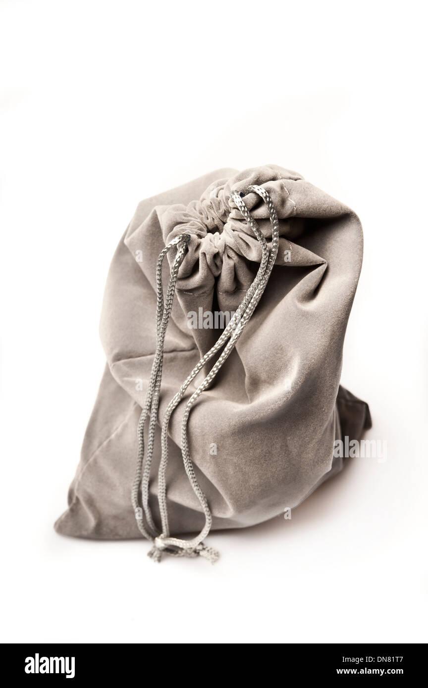 grey velvet pouch - Stock Image