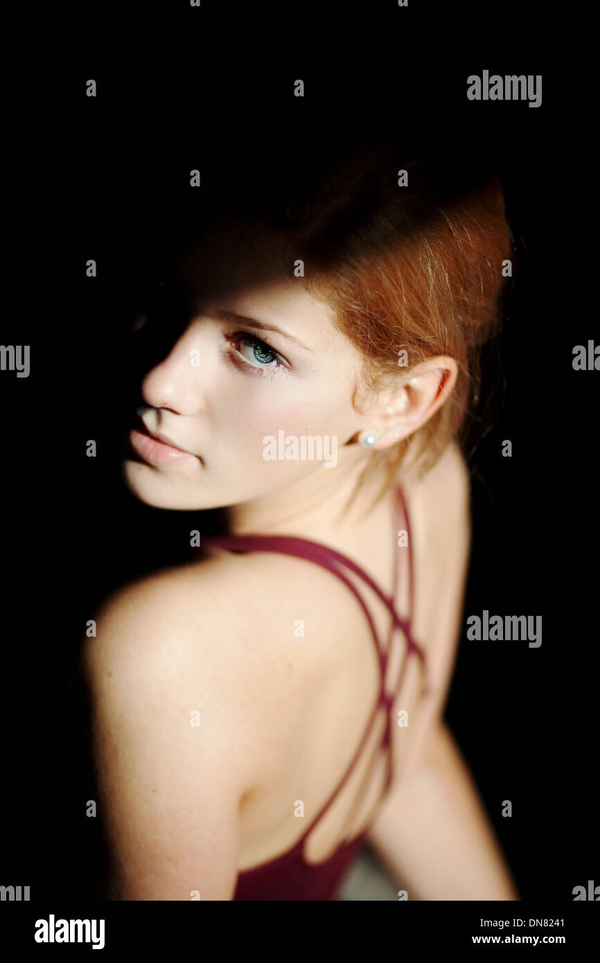Portrait of a young woman, light and shadow Stock Photo