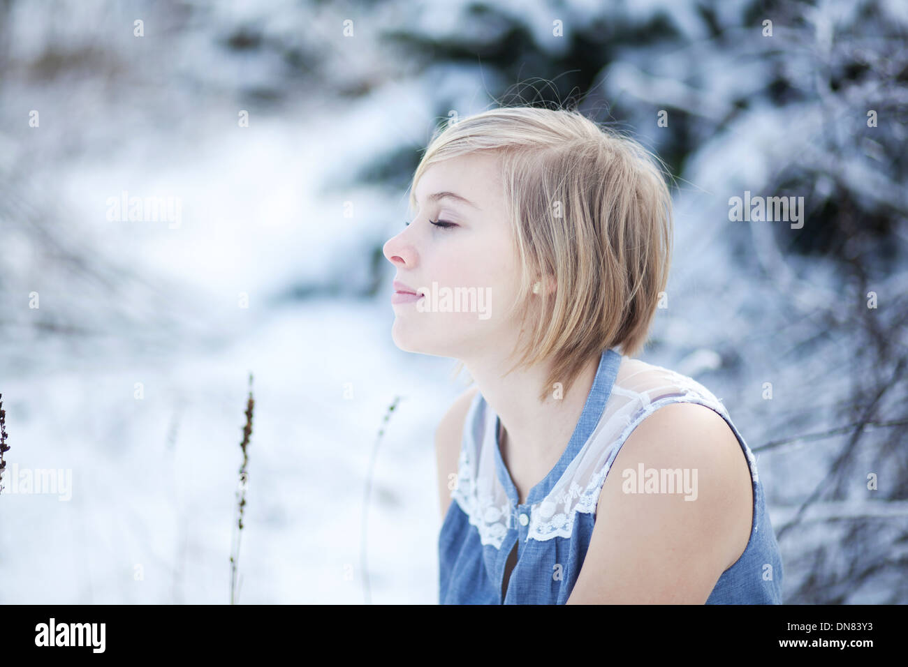 Portrait of a young woman in snow - Stock Image