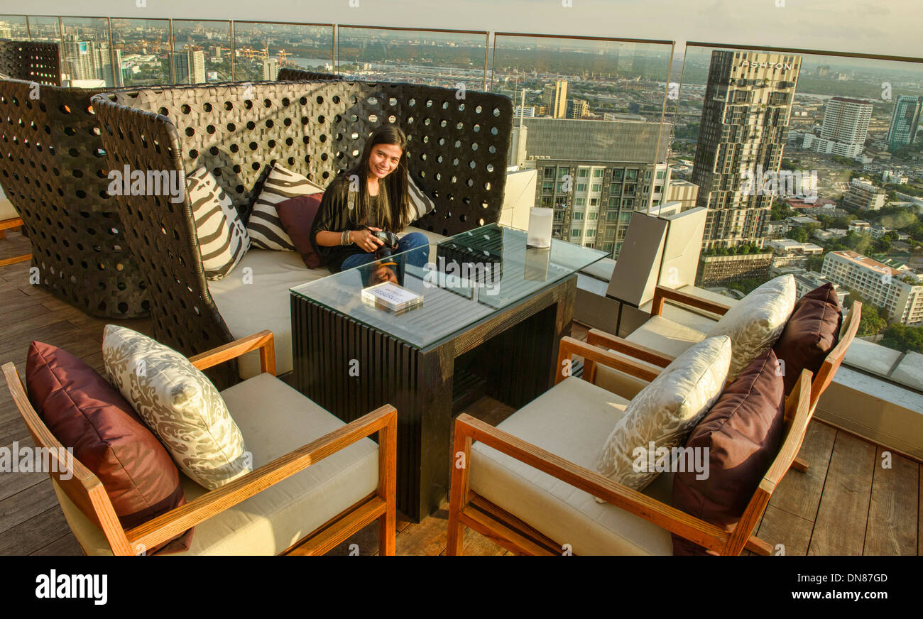 enjoying a drink on a rooftop bar in Bangkok, Thailand - Stock Image