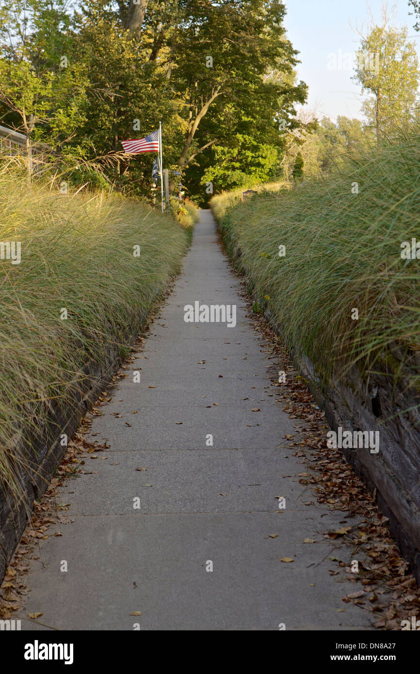 Beach path surrounded by dune grass in historic Ottawa Beach near Holland, Michigan - Stock Image