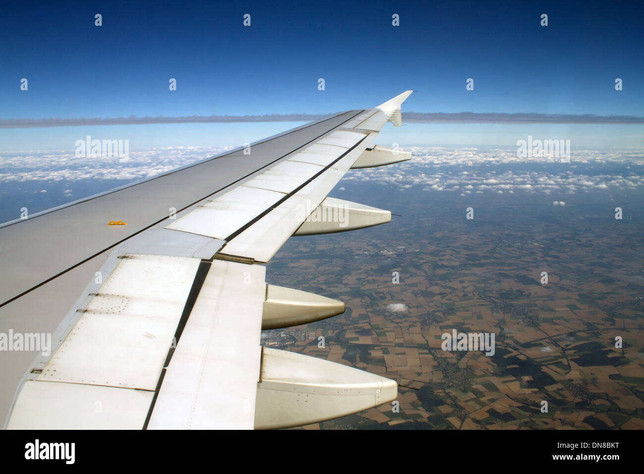 Airplaine view with the airplane wing. - Stock Image