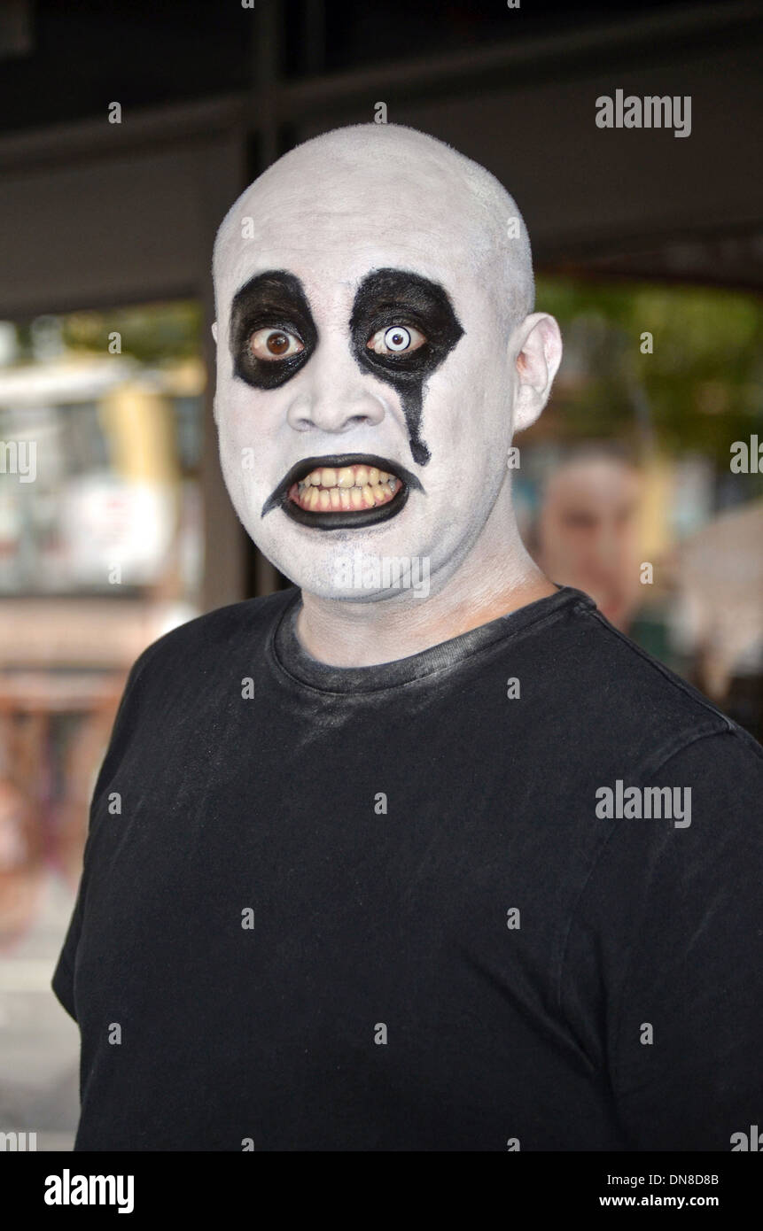 A man in whiteface, black eyes & unusual contact lenses on the streets of Greenwich Village in New York City Stock Photo