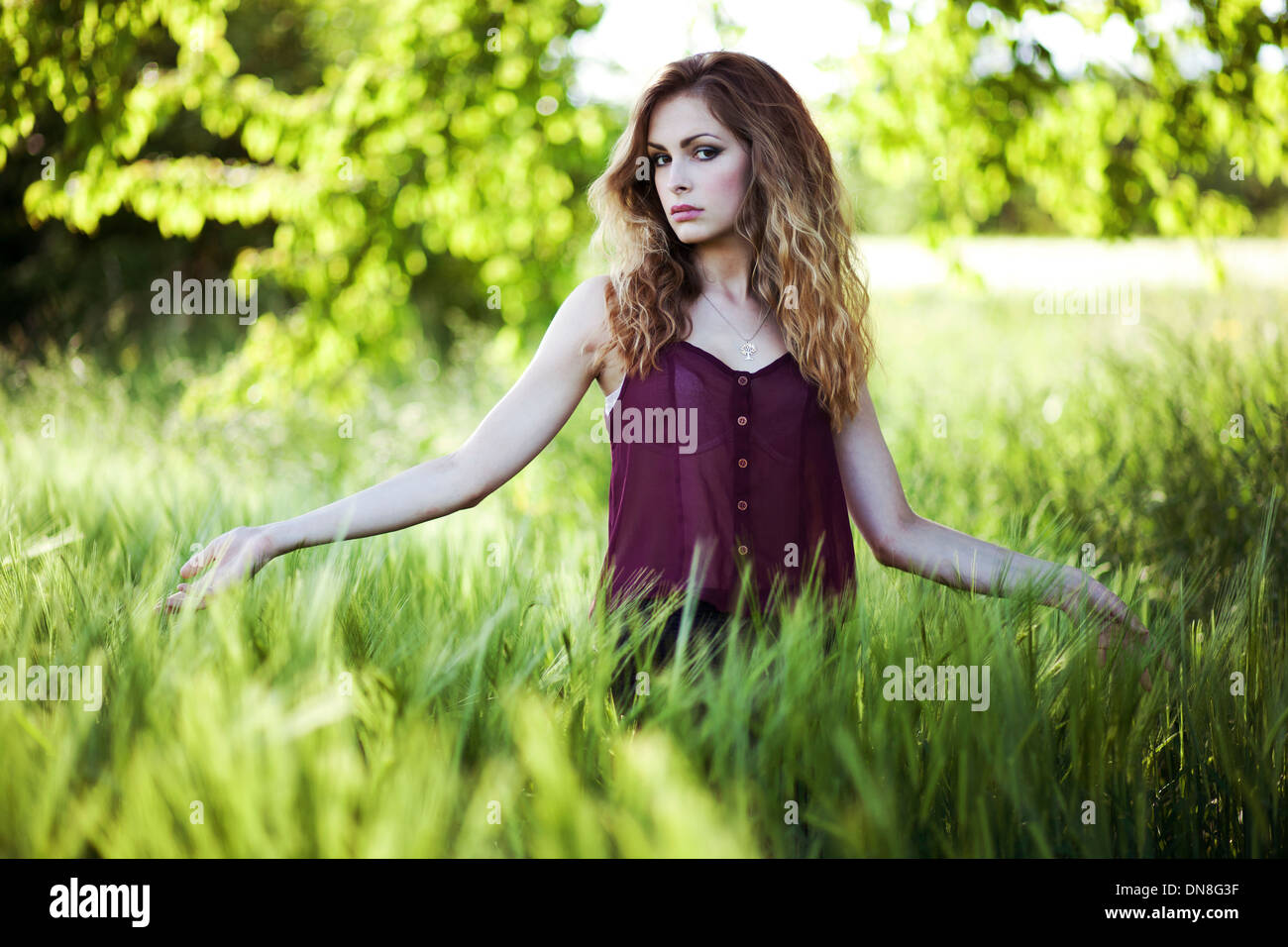 Portrait of young woman looking at camera Stock Photo