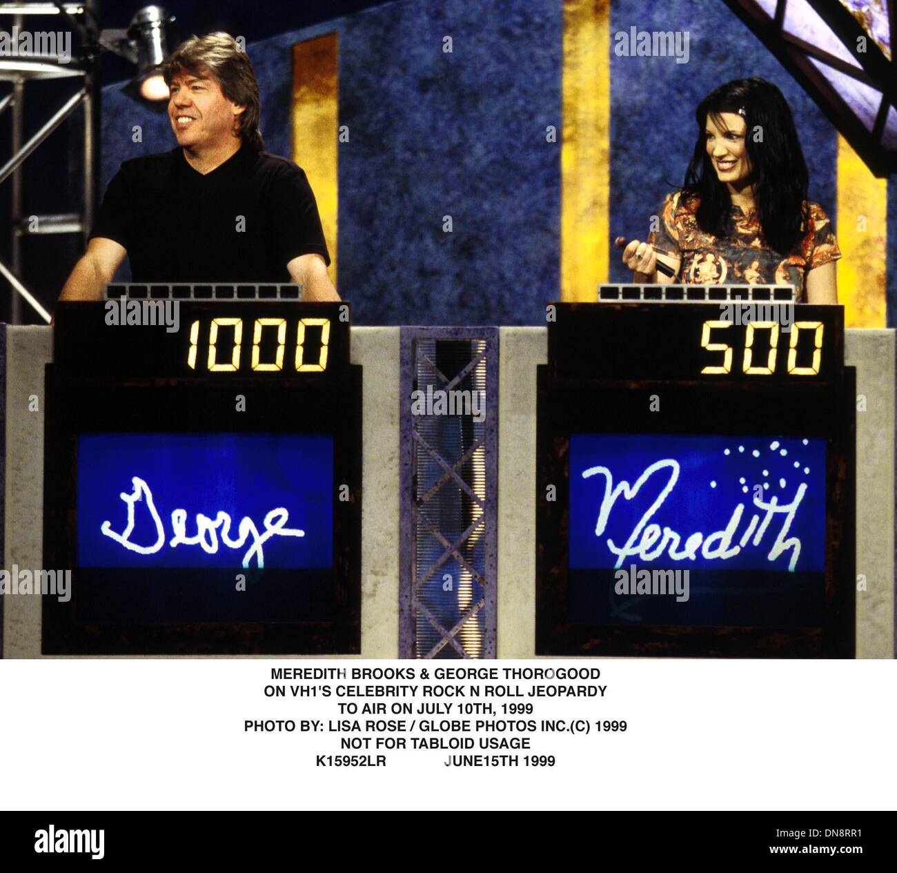 June 15, 1999 - K15952LR     06/15/99.***NOT FOR TABLOID USAGE***.MEREDITH BROOKS & GEORGE THOROGOOD.ON VH 1'S CELEBRITY ROCK N ROLL JEOPARDY.TO AIR ON JULY 10th, 1999.. LISA ROSE/   1999(Credit Image: © Globe Photos/ZUMAPRESS.com) - Stock Image