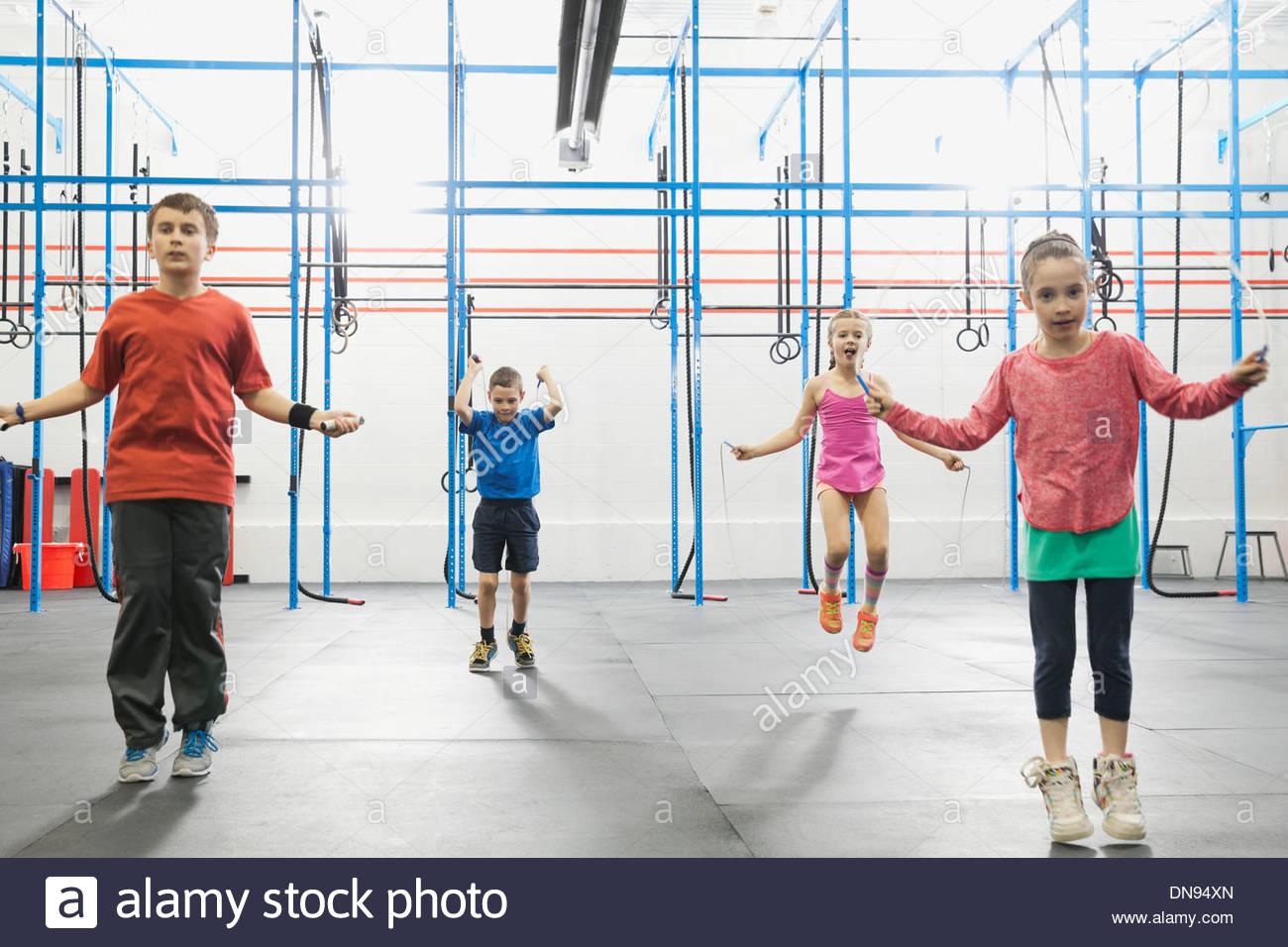 Children skipping in gym - Stock Image