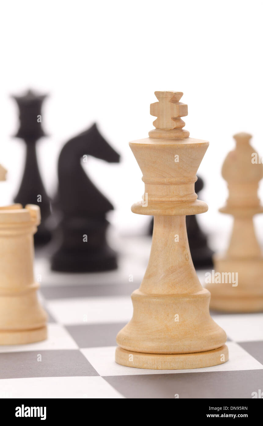 traditional wooden chess pieces on chessboard in different positions