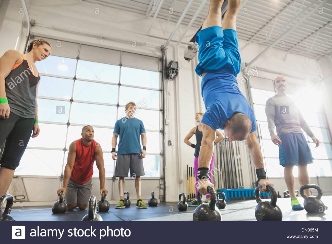 Man practicing kettlebell handstand - Stock Image