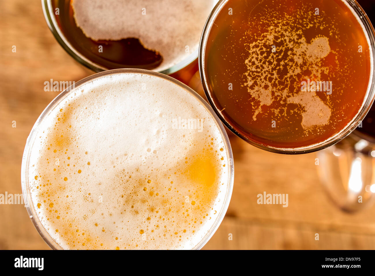 Pints of ale and beer in glasses on a table, UK - Stock Image