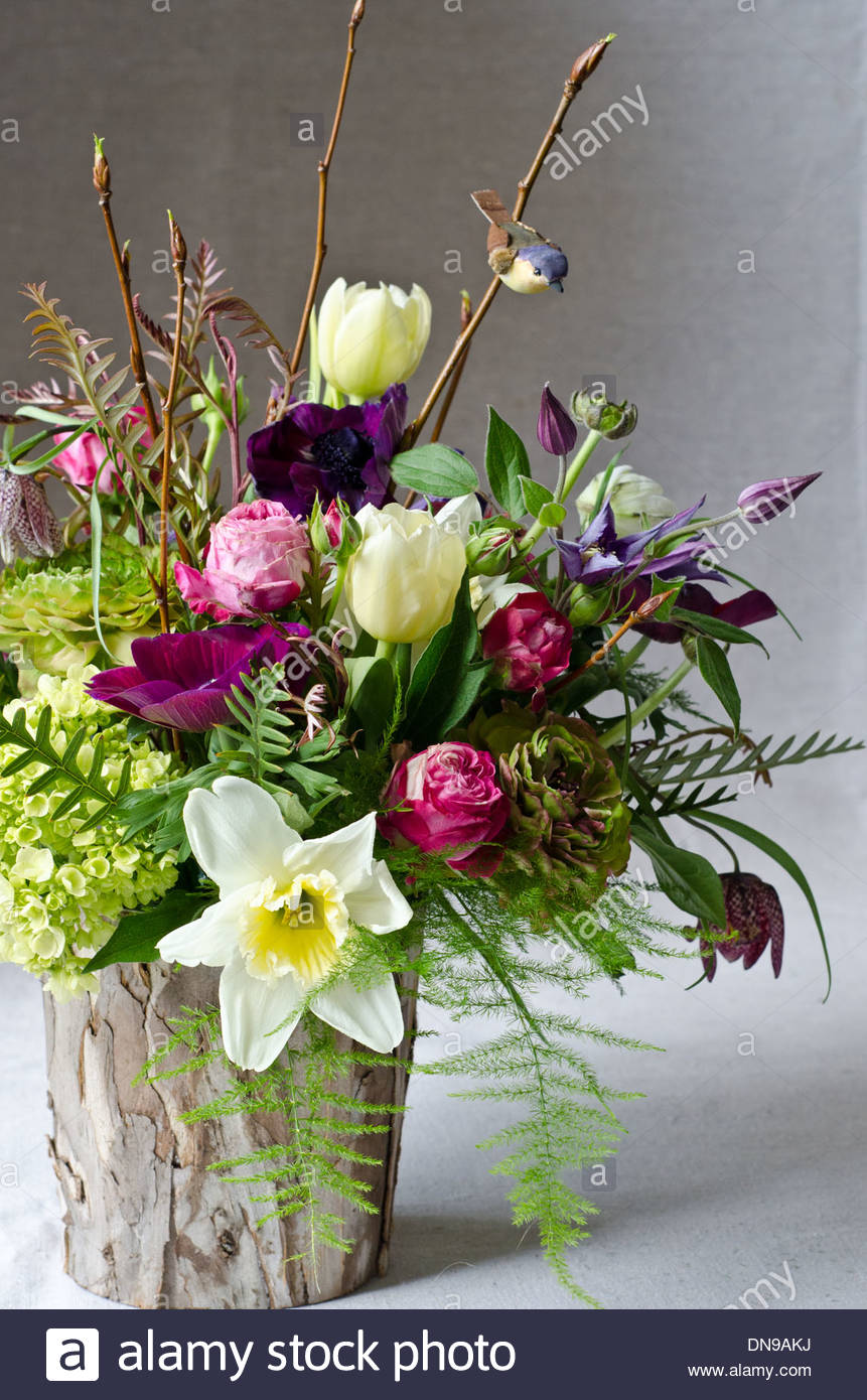 Spring Flower Arrangement With Tulips And Daffodils In