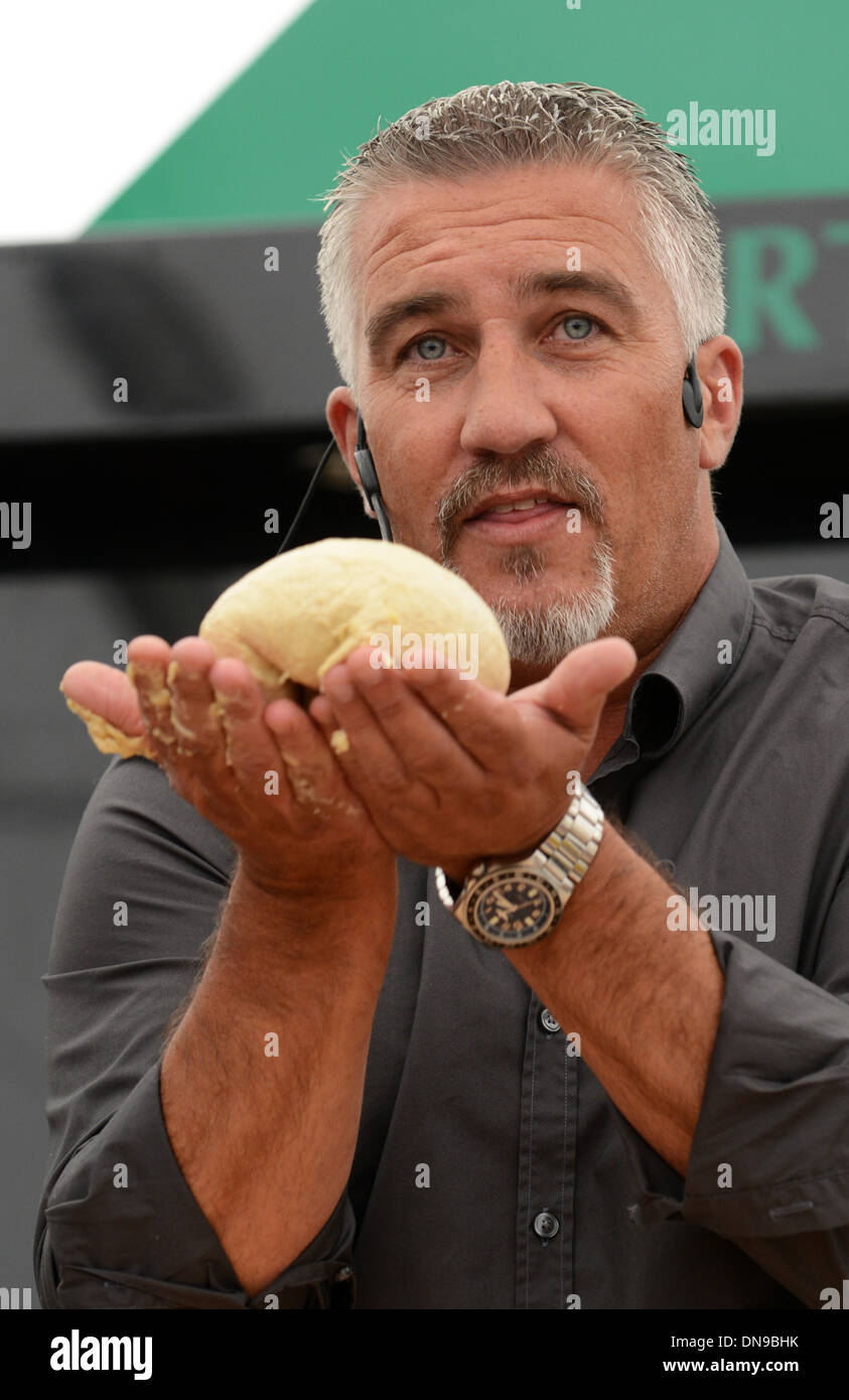 Television celebrity baker Paul Hollywood demonstrating his baking. - Stock Image