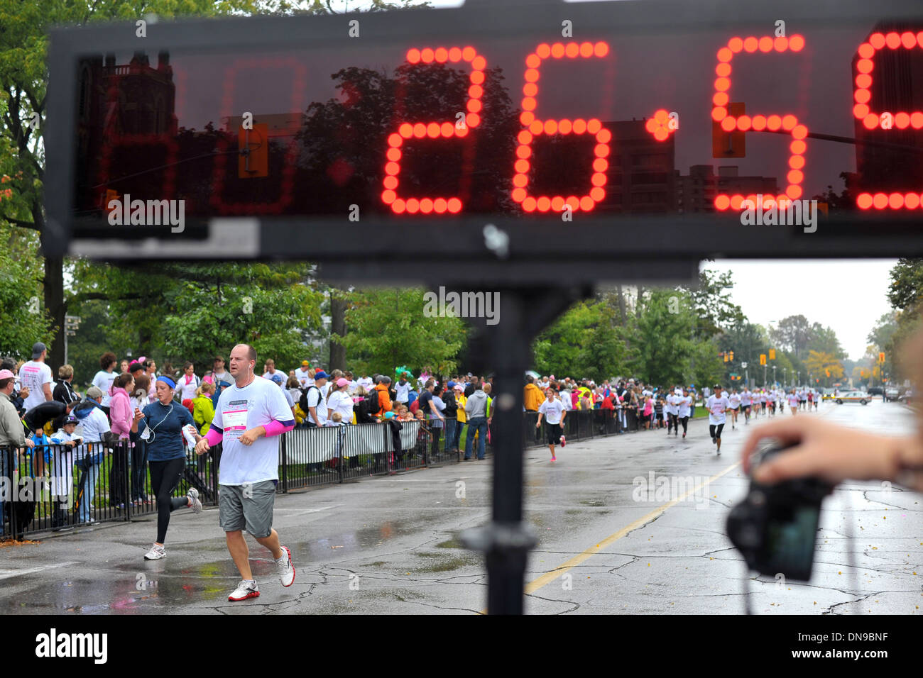 The finish line and timing screen at the end of a charity run. - Stock Image