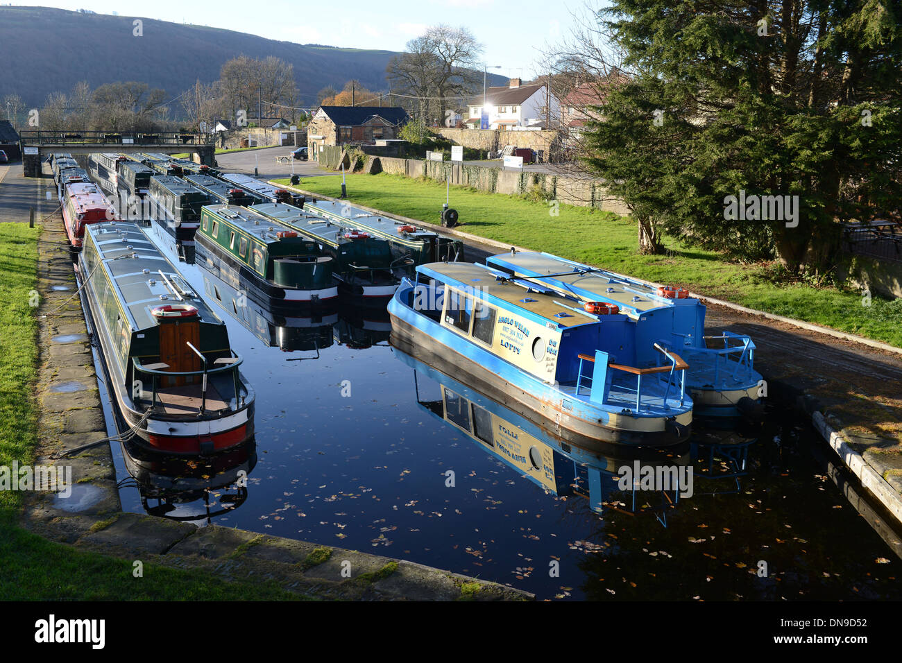 Narrowboats moored for winter at Trevor Canal Basin on the Llangollen Canal in Wales Uk - Stock Image