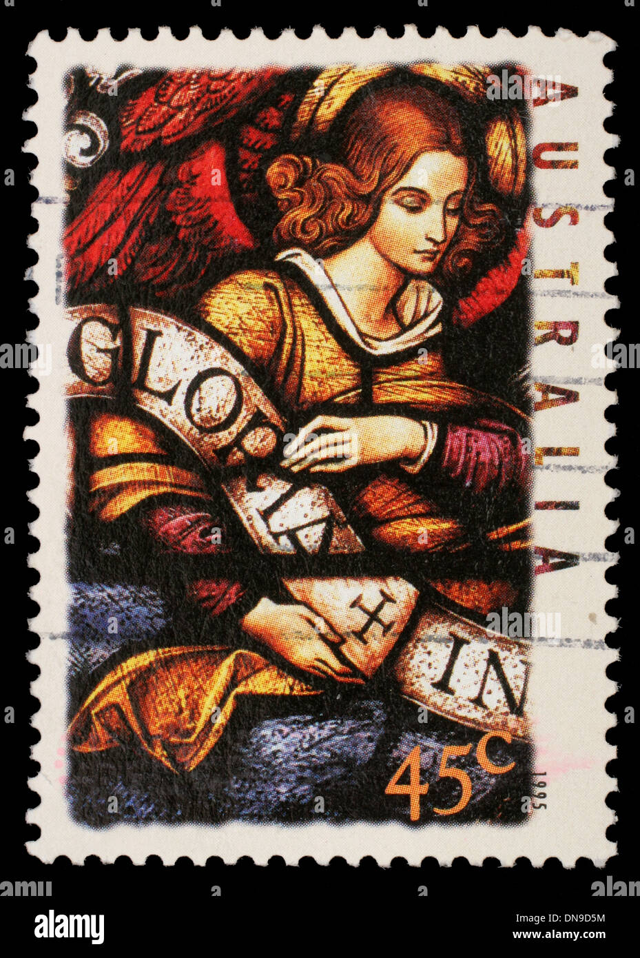 AUSTRALIA - CIRCA 1995: A stamp printed in Australia shows Angel with Gloria in excelsis Deo Banner, circa 1995 - Stock Image