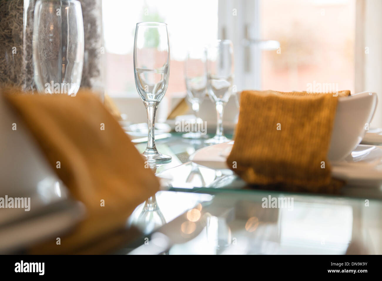 A kitchen with glasses laid on a table - Stock Image
