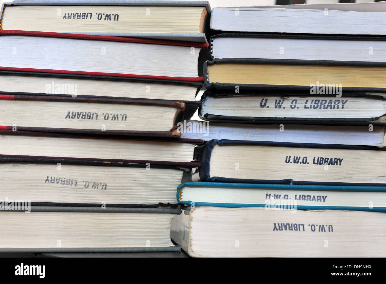 A stack of academic books on mothering and race. - Stock Image
