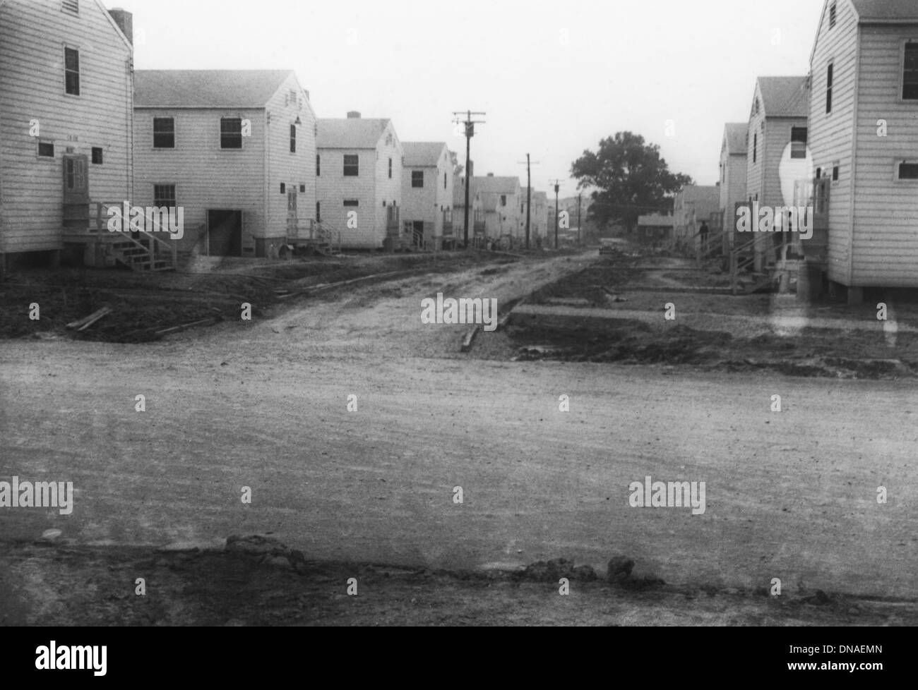 Military Buildings Along Dirt Road, WWII, 2nd Battalion, 389th Infantry, US Army Military Base Indiana, USA, 1942 - Stock Image