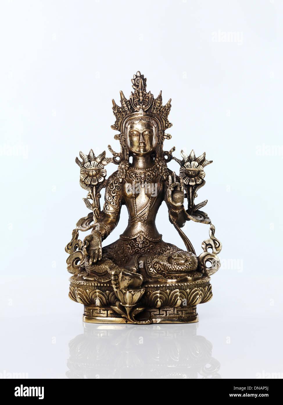Green Tara statue Buddhist goddess of compassion. Isolated on white background. - Stock Image