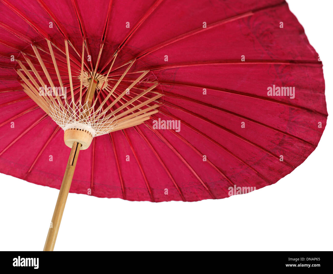 Red oriental paper umbrella, Japanese parasol isolated on white background - Stock Image