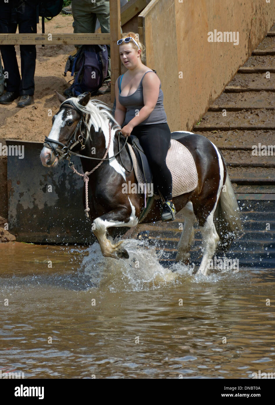 Gypsy traveller girl riding horse in River Eden. Appleby Horse Fair, Appleby-in-Westmorland, Cumbria, England, United Kingdom. - Stock Image