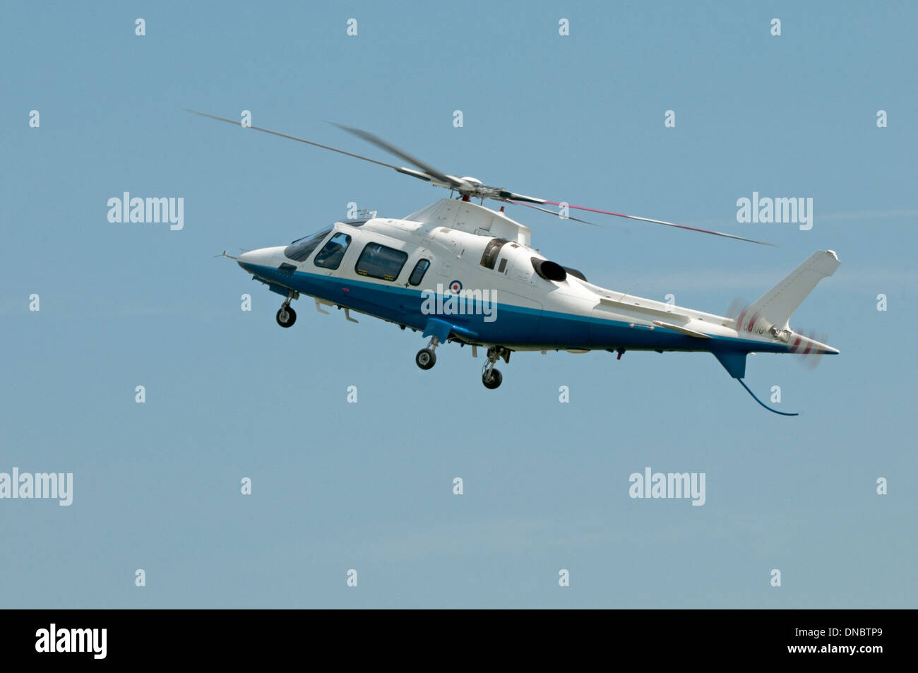 Agusta Westland AW109 Helicopter in flight - Stock Image