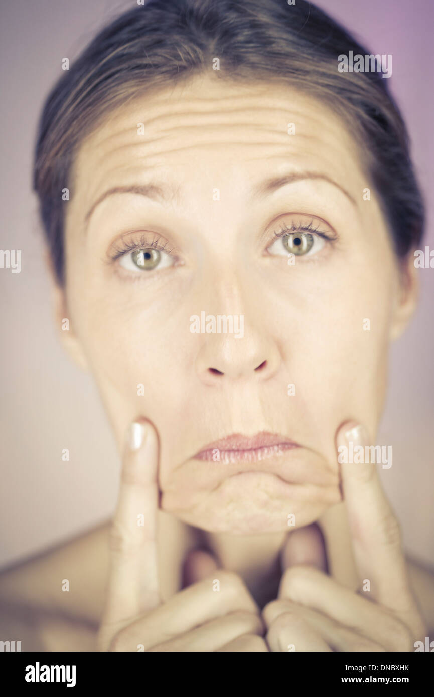 A woman with a sad expression - Stock Image