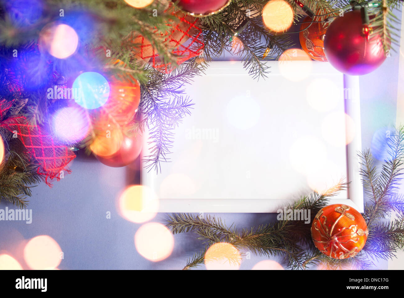 Colorful abstract background with Christmas lights and white frame ...