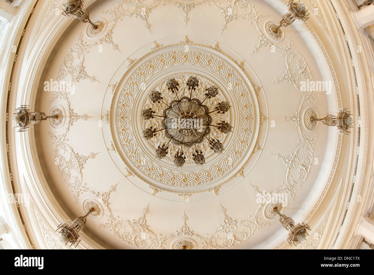 Ceiling and chandelier in one of the rooms of the Palace of the Parliament in Bucharest, the capital of Romania. - Stock Image