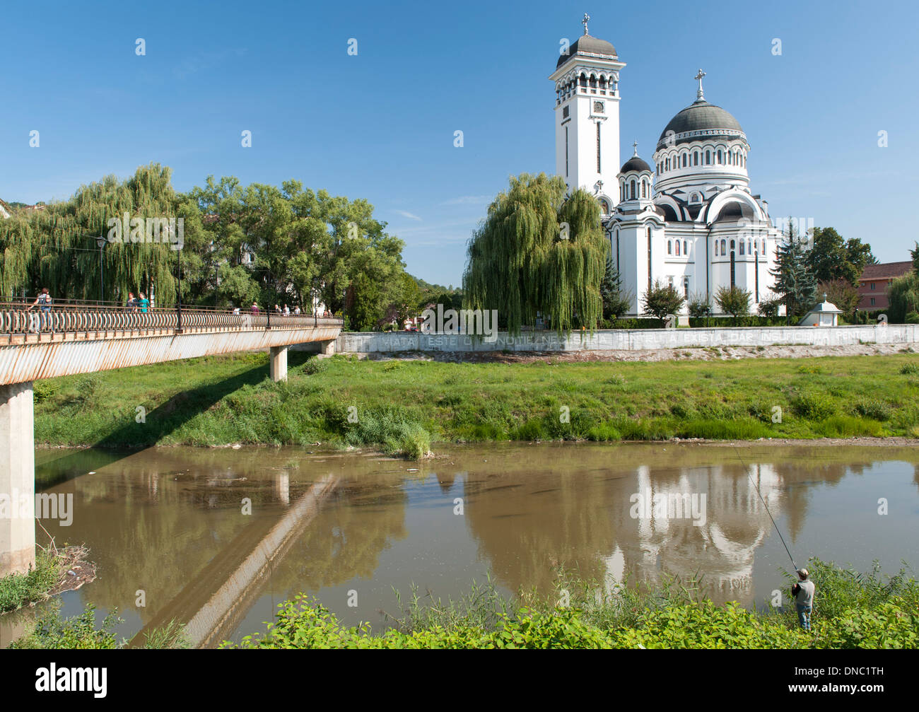 The Holy Trinity Church on the Târnava Mare River in Sighișoara in the Transylvania region of central Romania. - Stock Image