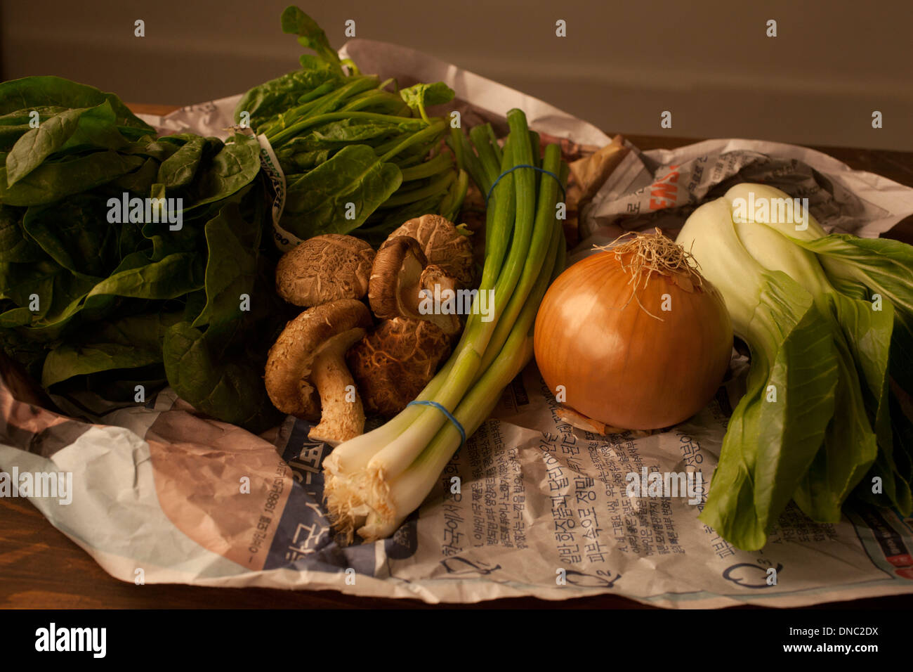 Vegetable still life laid out on table - Stock Image
