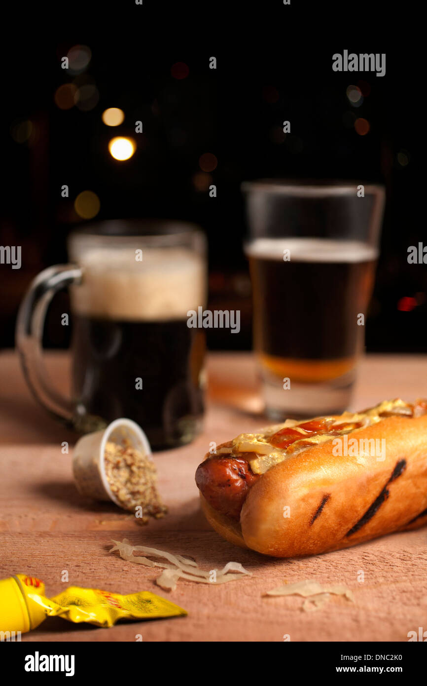 Hot dog with mustard and beer Stock Photo