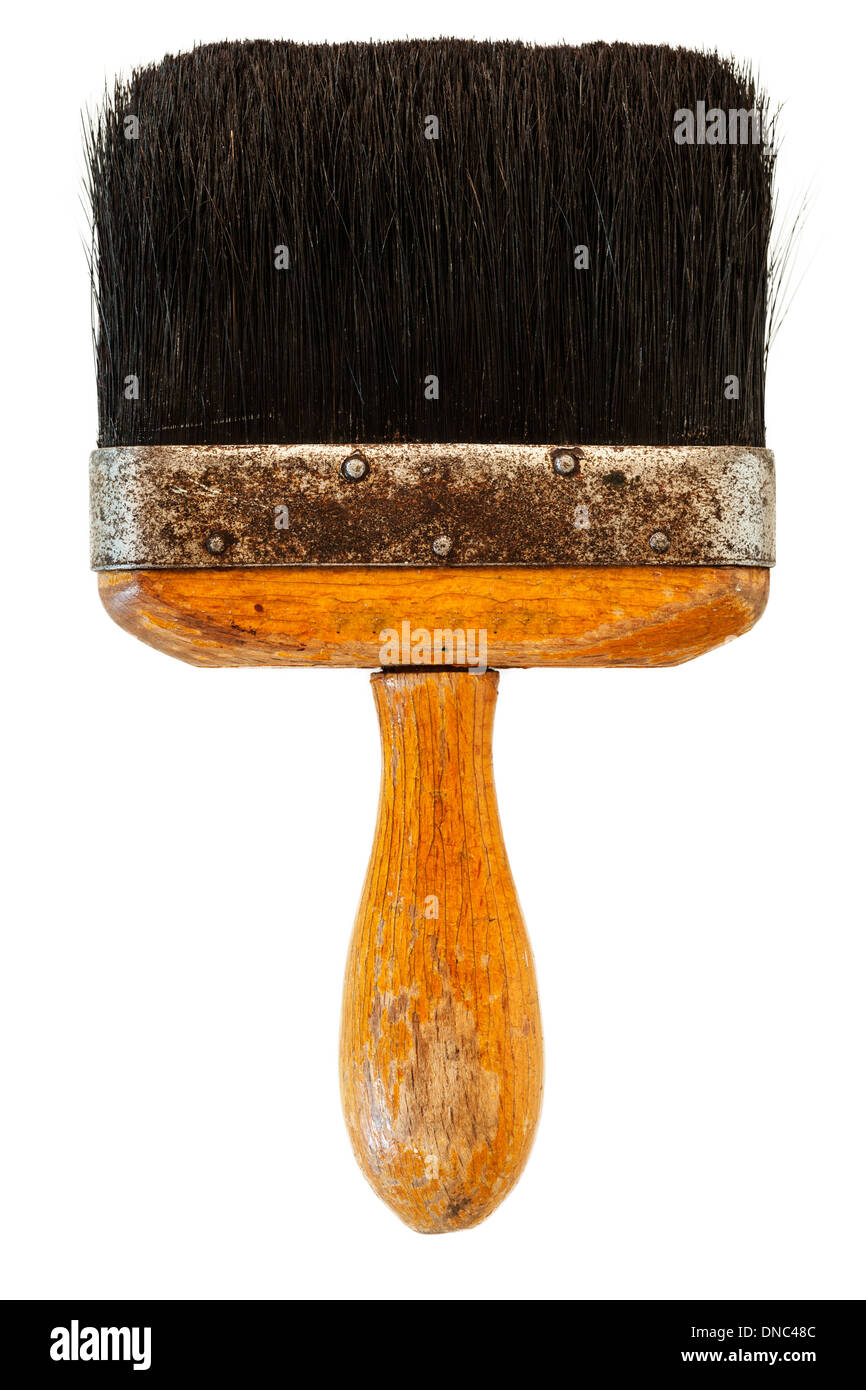 A vintage brush for wall papering on a white background - Stock Image