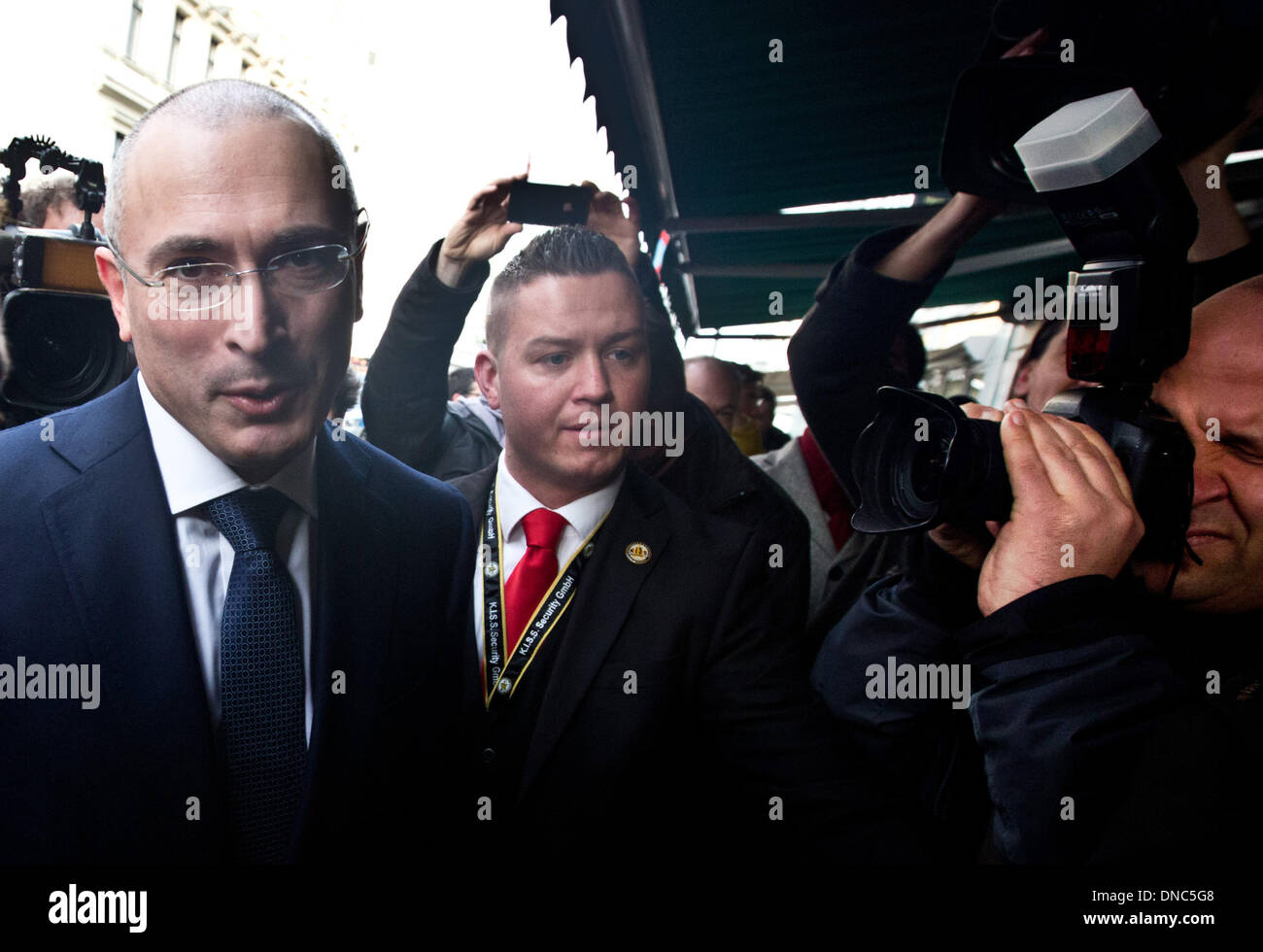 Berlin, Germany. 22nd Dec, 2013. Russian former oil tycoon Mikhail Khodorkovsky arrives to hold a press conference at the Berlin Wall Museum, in Berlin, Germany, 22 December 2013 to discuss his future plans, two days after he received a pardon from prison from Russian President Vladimir Putin. Khodorkovsky, 50, who was once the richest man in Russia and spent 10 years in jail after being convicted of tax evasion and embezzlement, flew to Berlin on 20 December 2013. He has been given a one-year visa by Germany. Photo: Kay Nietfeld/dpa/Alamy Live News - Stock Image