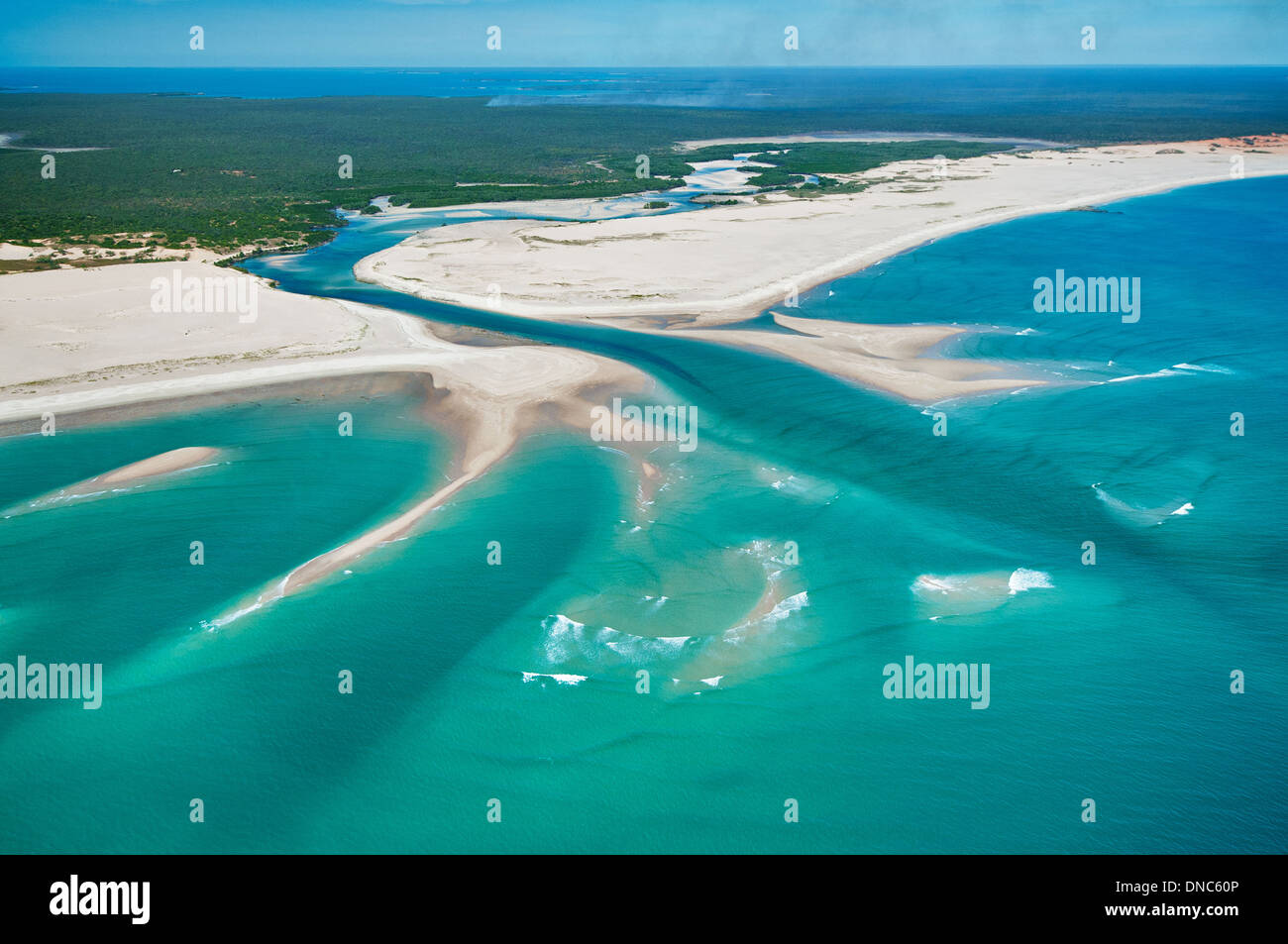 Sandy patterns at the mouth of Hunter Creek. - Stock Image