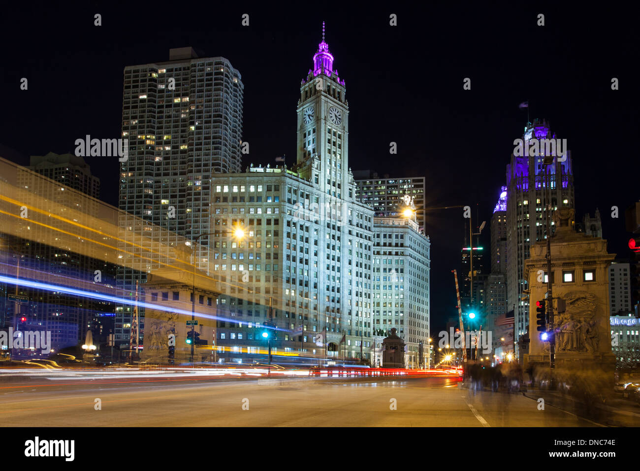 Chicago rush hour traffic from Lower Wacker Drive towards the Wrigley Building on Michigan Avenue in Illinois, USA - Stock Image