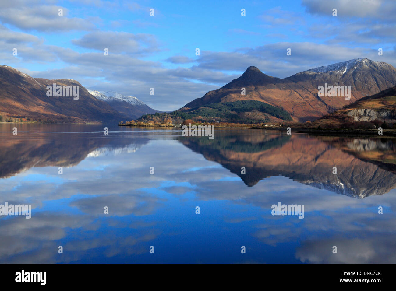 Pap of Glencoe reflected in the glass calm Loch Leven in Ballachulish, Highlands, Scotland - Stock Image