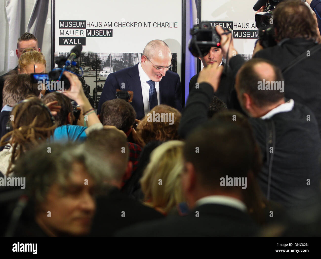 Berlin, Germany. 22nd Dec, 2013. Mikhail Khodorkovsky (C) leaves after a press conference in Berlin, Germany, on Dec. 22, 2013. Mikhail Khodorkovsky, a former oil tycoon and one of Russia's most famous prisoners, said here on Sunday that he will not engage in Russian politics or fund the country's political opposition. Credit:  Zhang Fan/Xinhua/Alamy Live News - Stock Image