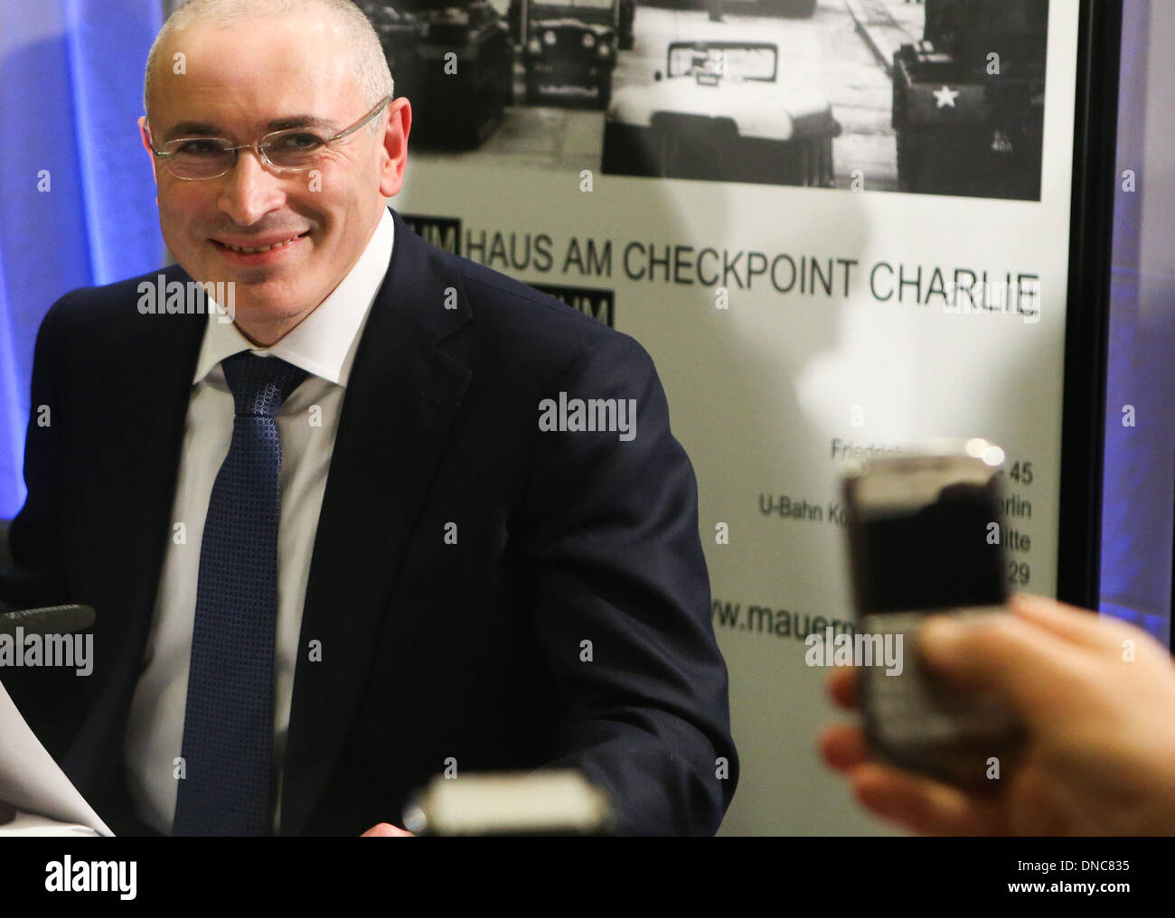 Berlin, Germany. 22nd Dec, 2013. Mikhail Khodorkovsky smiles during a press conference in Berlin, Germany, on Dec. 22, 2013. Mikhail Khodorkovsky, a former oil tycoon and one of Russia's most famous prisoners, said here on Sunday that he will not engage in Russian politics or fund the country's political opposition. Credit:  Zhang Fan/Xinhua/Alamy Live News - Stock Image